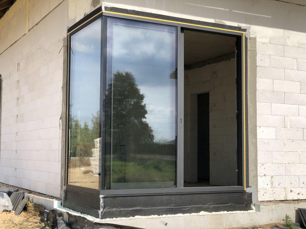 Aluminiowe drzwi tarasowe unoszono-przesuwne HST CORTIZO 4600 HI IT z glasscornerem