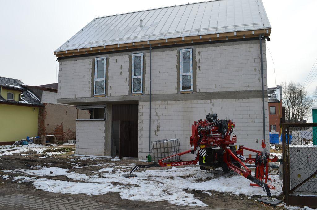 Dom jednorodzinny gdzie zostały zamontowane i przeszklone 10 metrowe drzwi tarasowe